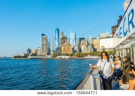 New York City - October 18, 2016:  Tourists viewing Statue of Liberty from the Circle Line boat tour of Ellis Island, New York, New York