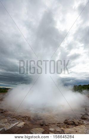 Strokkur geyser blowing high Iceland in June