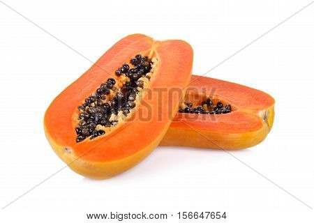 half cut ripe papaya with seed on white background