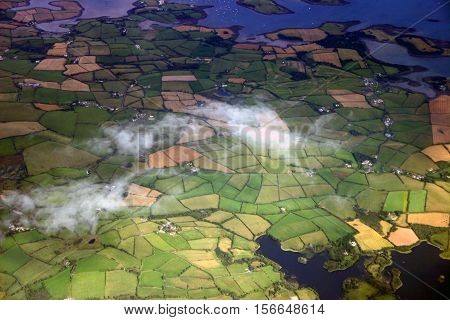 Northern Ireland Aerial shot. Green fields and clouds.