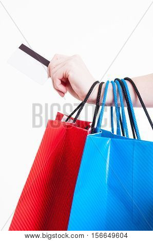 Hand Holding Credit Card And Bunch Of Shopping Bags