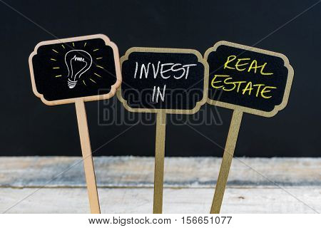 Concept Message Invest In Real Estate And Light Bulb As Symbol For Idea