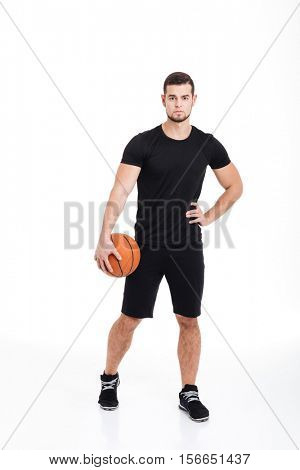 Full length sportsman with ball. basket-ball. isolated white background