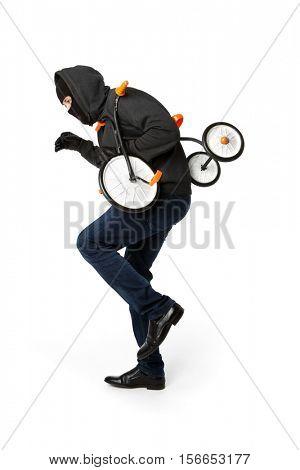 Burglar stealing small children's bicycle