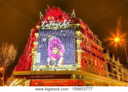 ParisFrance- December 21 2014: Night aspect of Galleries Lafayette decorated for winter holidays in Paris on December 21 2015.