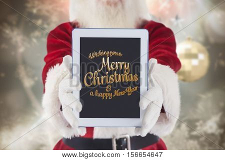 Santa claus showing christmas and new year greeting on digital tablet screen during christmas time