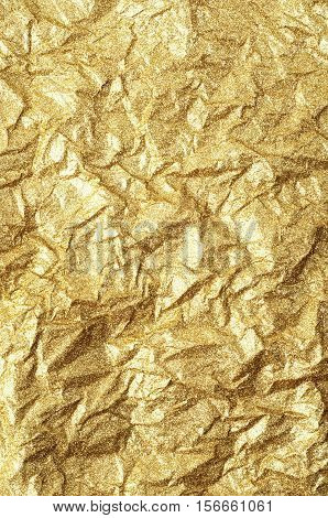 Gold wrinkled paper texture abstract background. Gold texture