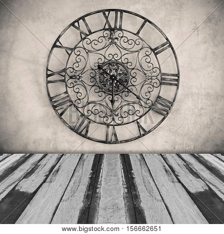 Abstract classic clock on wall with planks floor