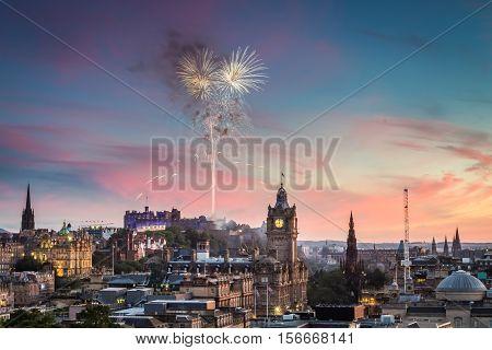 Fireworks over Edinburgh Castle at sunset in summer