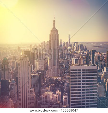 Aerial view of Manhattan skyline at sunrise, New York City, USA. Vintage style image