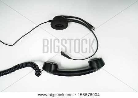 isolated black headset with IP headphone on table