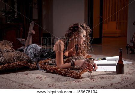 young beautiful brunette woman lying on a fur mat
