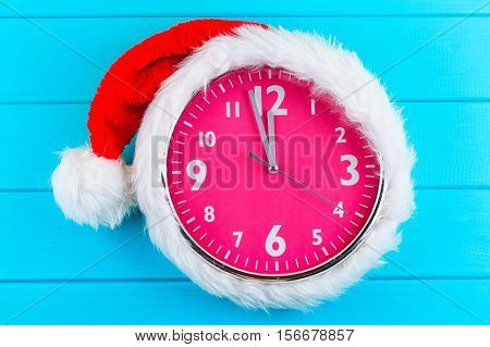 the pink clock with christmas santa hat