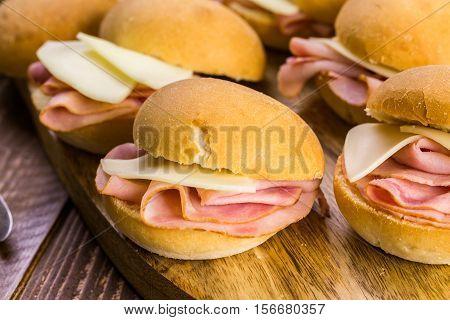Ham and cheese sliders on homemade dinner rolls.