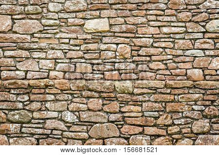 Old medieval wall made from stone as background