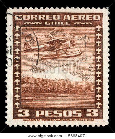 ZAGREB, CROATIA - JUNE 24: A stamp printed in Chile shows Stinson Faucett F.19 seaplane in flight, circa 1934, on June 24, 2014, Zagreb, Croatia