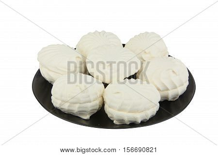 Delicious white vanilla marshmallow on a plate on a white background