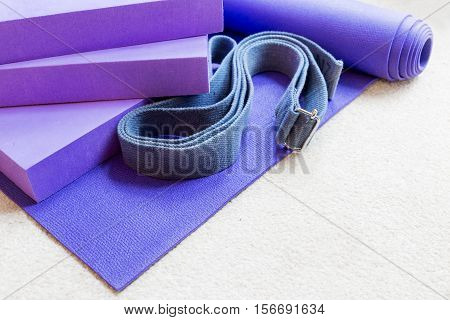 Fitness yoga pilates equipment props on a carpet