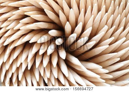 Pile bamboo toothpicks arranged in spiral. Close-up