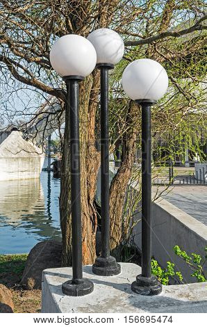 Round street lights in the Old Park in early spring