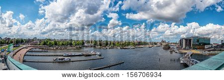 Amsterdam Netherlands - August 1 2016: Cityscape of Amsterdan a blue sky day with pretty white clouds from Nemo Science Museum