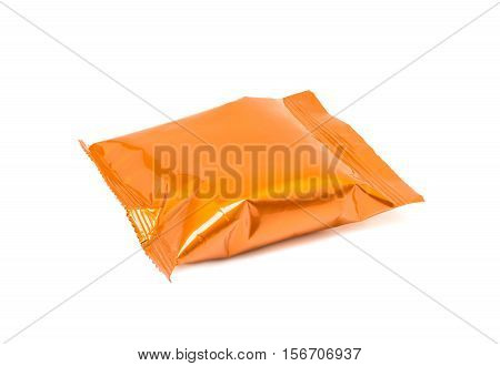 blank packaging orange aluminum foil snack pouch isolated on white background