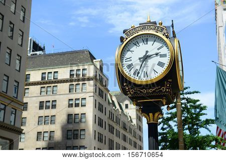 NEW YORK CITY - MAY 26, 2014: Clock in front of Trump Tower on Fifth Avenue in midtown Manhattan, New York City, USA.