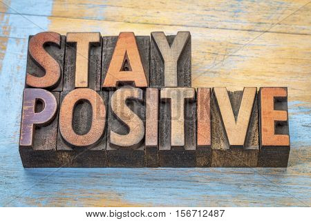 stay positive - motivational word abstract in vintage letterpress printing  blocks