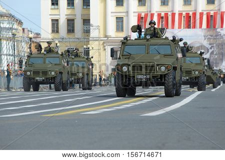 SAINT PETERSBURG, RUSSIA - MAY 05, 2015: The multi-purpose army Tiger cars in a column of military equipment at Palace Square. A parade rehearsal in honor of the Victory Day