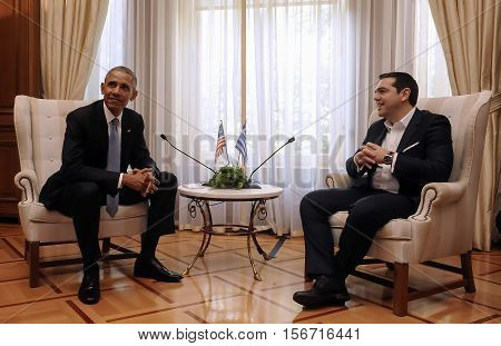 Greek Prime Minister Alexis Tsipras, Right, Speaks With U.s. President Barack Obama