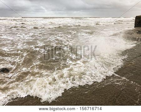 SCARBOROUGH ENGLAND - NOVEMBER 6: Waves crashing against sea defenses in Scarborough. In Scarborough England. On 6th November 2016.