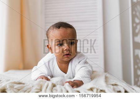 Portrait of a cute mixed race baby boy.