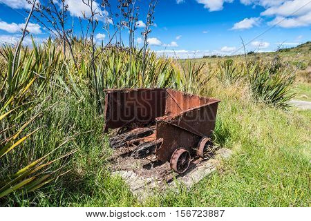 Old historic mine trolley from the Victorian period abandoned and decaying New Zealand