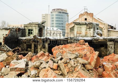 Tyumen, Russia - February 16, 2008: Demolition of machine-tool factory. Destroyed building on foreground