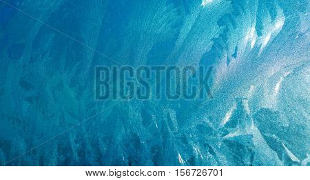 Turquoise Frost Background, Closeup Frozen Winter Window Pane Coated Shiny Icy Frost Patterns, Extreme North Low Temperature, Natural Ice Pattern on a Frosty Glass poster