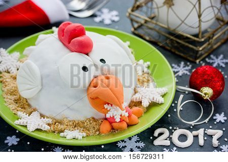 Rooster cake (cock cake hen cake chicken cake bird cake) - festive cake shaped Red Fire Rooster simbol New Year 2017 on Chinese calendar. Merry Christmas and Happy New Year 2017 food background