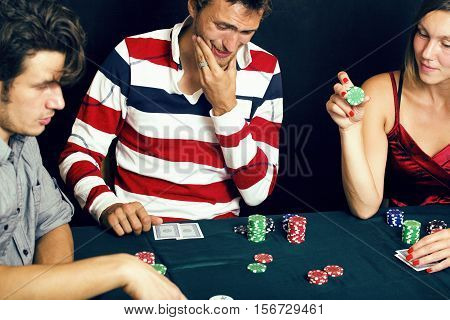 young people playing poker off-line tournament, friends party concept at home