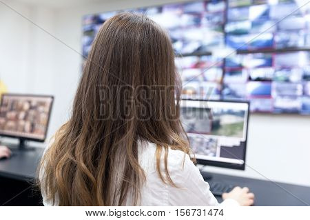 CCTV control room operator. Security video surveillance.
