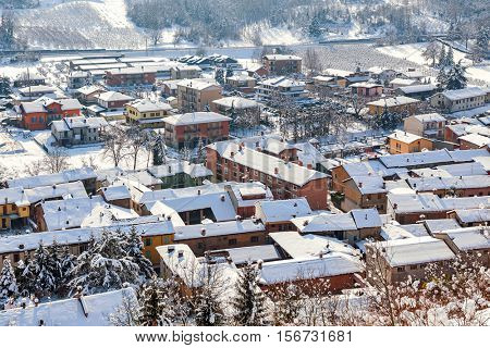 View from above on small town covered with snow in Piedmont, Northern Italy.