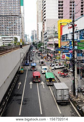 People And Vehicles On Street In In Manila, Philippines