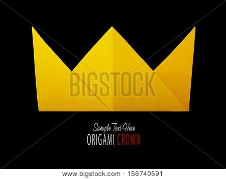 Origami paper yellow gold king crown irony on a black background