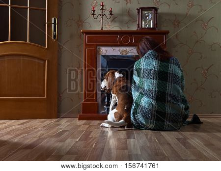 Woman In The Plaid With Beagle Near A Fireplace