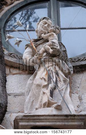 DUBROVNIK, CROATIA - NOVEMBER 29: Saint Joseph holding baby Jesus, portal of Saint Joseph church in Dubrovnik, Croatia on November 29, 2015.