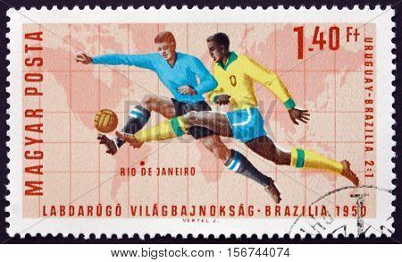 HUNGARY - CIRCA 1966: a stamp printed in Hungary shows Soccer Play Rio de Janeiro (Uruguay 2 Brazil 1) World Cup Soccer Championship 1966 Wembley England circa 1966