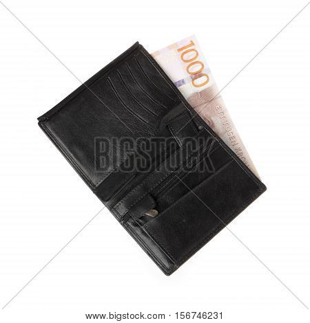 One black wallet containg one 1000 Swedish krona banknote isolated on white background.