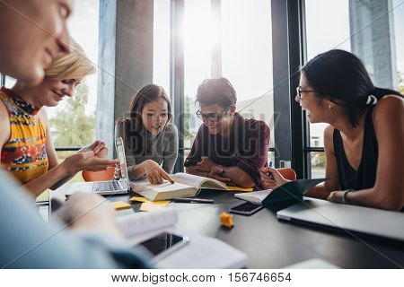University Students Doing Group Study In Library
