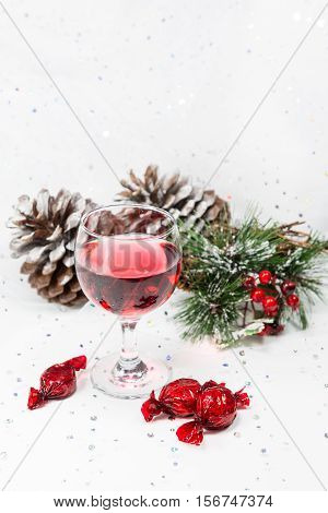 Luxury Wine And Chocolates With Pinecones And Snow. Copy Space.