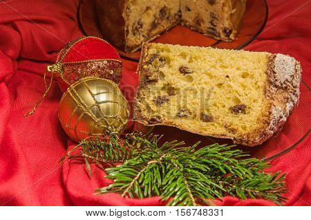 Cut Panettone, Branch Of Pine Tree And Baubles. Christmas Theme.