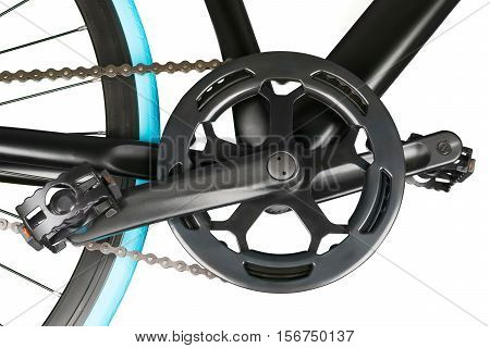 Close up of black bike crankset chainring and pedals. Isolated on white