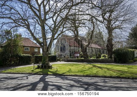 Saint George church and green int he village of Brede Kent UK
